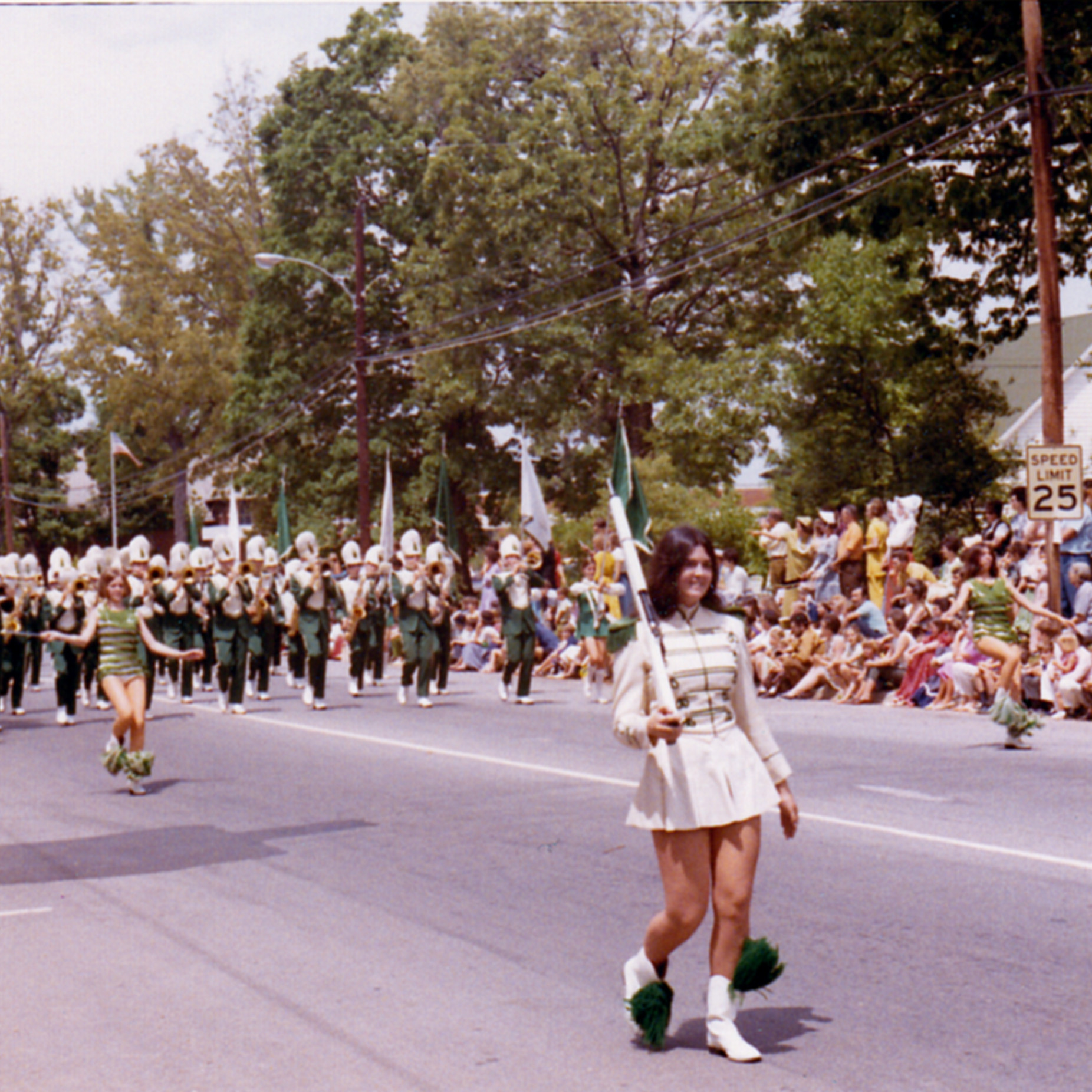 Photo of marchers in Cary, NC's centennial parade down Academy Street in 1971.
