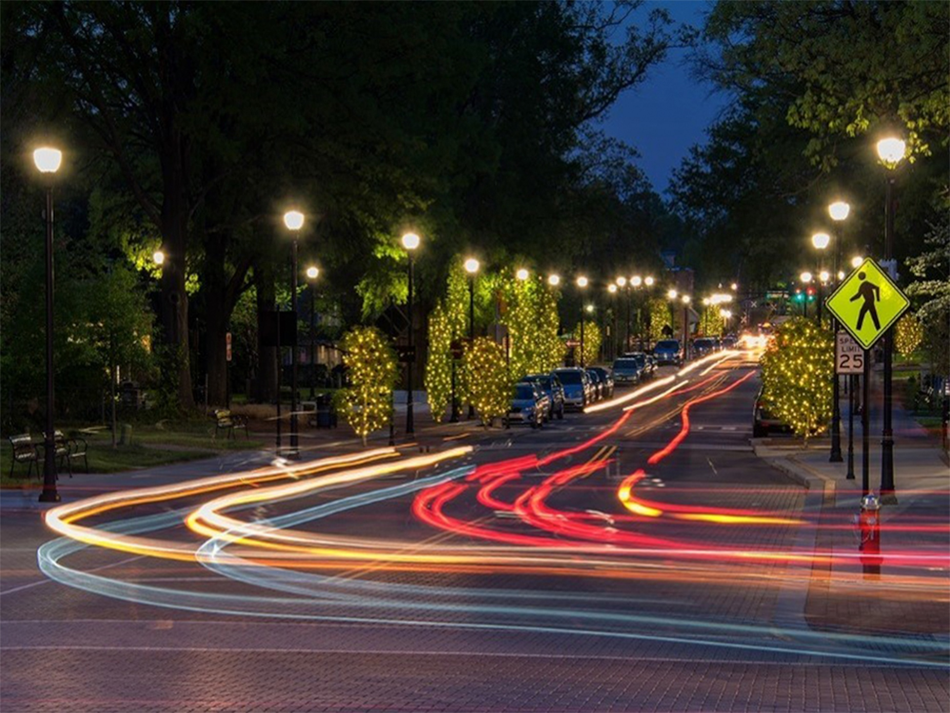 Photo of a road in downtown Cary, NC at night.