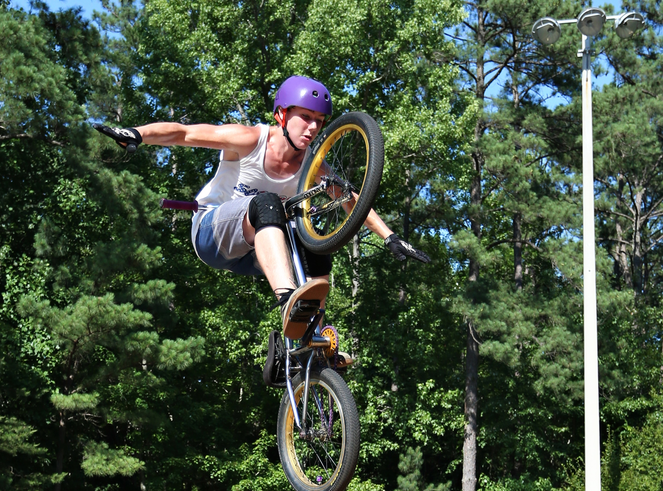 Photo of a woman riding a BMX at a skate park in Cary, NC.