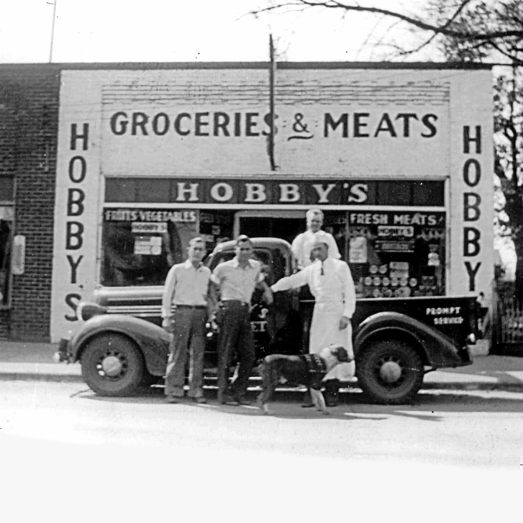 Photo of a group of men standing in front of Hobby's Grocery in Cary, NC