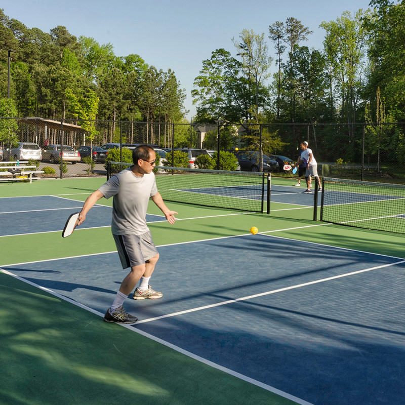 Photo of a man playing pickleball in Cary, NC